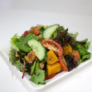 Garden Salad (Fresh mesculin mix with baked vegetables, pepitas, chickpeas, cucumber, tahini & honey dressing)